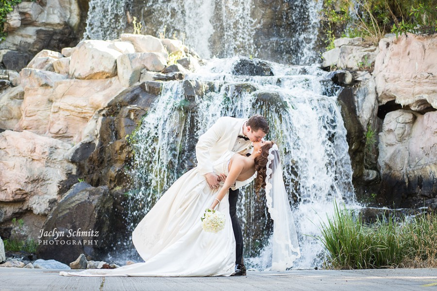 romantic kiss dip shot wedding