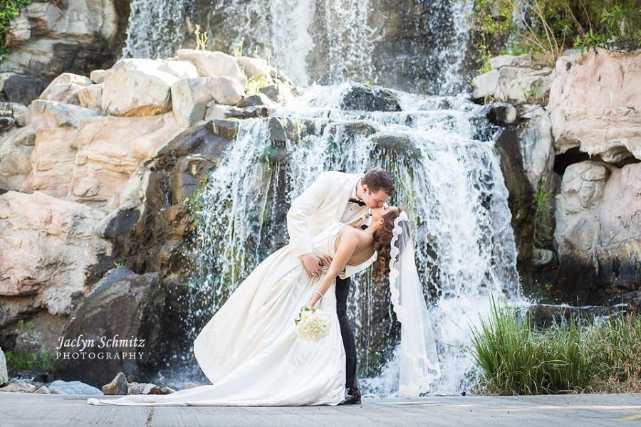 romantic kiss dip shot wedding